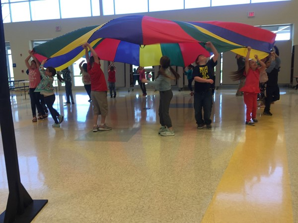West--Practice with the parachute.