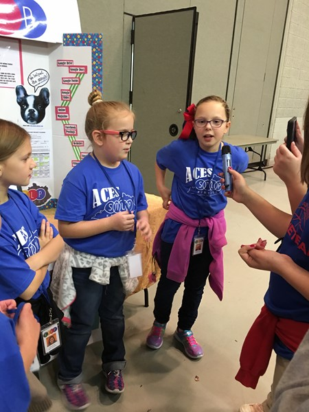 "Adair County Elementary students present their ""Doggie Dash"" project at the Regional STLP Showcase"